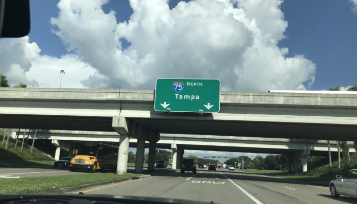 Approaching Tampa Sign on the Road